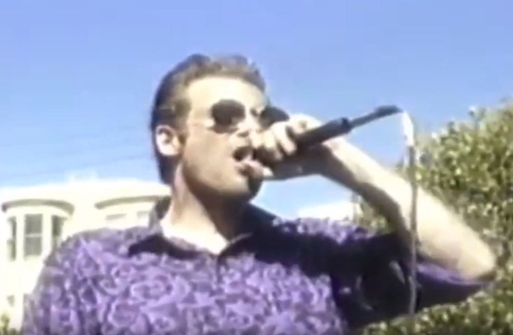 Bruce from Flipper on stage holding the mic at The 1994 Making Waves Festival May 27th 1994